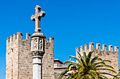 City gate with column and stone cross, Mallorca, Spain