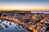 Procida, sunset over La Corricella harbour. Naples, Campania, Italy