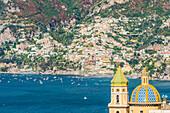 Praiano, Amalfi coast, Salerno, Campania, Italy. The church of Praiano with Positano village in the background