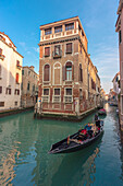 Picturesque view over two water canals in Venice, Veneto, Italy