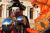 A couple of typical mask of Carnival of Venice with reflective spheres at San Marco square, Venice, Veneto, Italy
