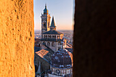 Basilica of Santa Maria Maggiore from a breach in the Civic Tower during sunset. Bergamo(Upper town), Lombardy, Italy.