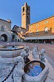 Piazza Vecchia with civic tower and Fontana del Contarini. Bergamo(Upper Town), Lombardy, Italy.
