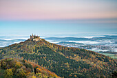 Hohenzollern castle in autumnal scenery at dawn. Hechingen, Baden-Württemberg, Germany.