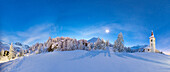 Panoramic of snowy landscape and Chiesa Bianca at night, Maloja, Bregaglia Valley, Canton of Graubunden, Engadin, Switzerland