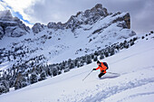 Man backcountry skiing descending from Medalges, Medalges, Natural Park Puez-Geisler, UNESCO world heritage site Dolomites, Dolomites, South Tyrol, Italy