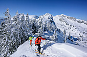 Two persons backcountry skiing ascending towards Wildalpjoch, Wildalpjoch, Bavarian Alps, Upper Bavaria, Bavaria, Germany