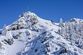 Three persons backcountry skiing ascending towards Wildalpjoch, Wildalpjoch, Bavarian Alps, Upper Bavaria, Bavaria, Germany