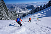 Three persons backcountry skiing descending from Wildalpjoch, Wildalpjoch, Bavarian Alps, Upper Bavaria, Bavaria, Germany