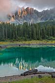 Lake Carezza (Karersee) with Mount Latemar at sunset. Carezza, Nova Levante, Ega Valley, Bolzano Province, South Tyrol, Trentino alto Adige Italy