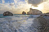 Cyprus, Paphos, Petra tou Romiou also known as Aphrodite's Rock, boys at the sunset standing over the rock