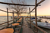 The lakefront restaurant of Punta San Vigilio on the eastern shore of Lake Garda, Verona province, Veneto, Italy.