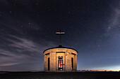 Monte Grappa, province of Vicenza, Veneto, Italy, Europe. On the summit of Monte Grappa there is a military memorial monument. Starry sky over the Sanctuary Madonna del Grappa