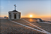 Monte Grappa, province of Vicenza, Veneto, Italy, Europe. On the summit of Monte Grappa there is a military memorial monument. The Sanctuary Madonna del Grappa at sunrise