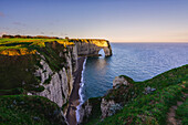 Arch in Etretat at sunrise ,Normandy,France.