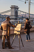 Tourist looks to the iconic Chain Bridge, Budapest, Hungary