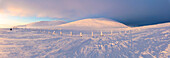 Panoramic of snow covered mountains at dusk, Pallas-Yllastunturi National Park, Muonio, Lapland, Finland