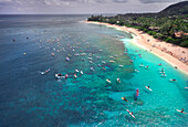 Paddleboarders lining up for paddle board race from Sunset Beach to Waimea Bay, Oahu, Hawaii, USA