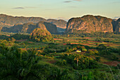 Sunrise over the limestone mogotes formations in the Vinales valley, Cuba