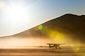 Backcountry airplane taxiing on a dry lakebed, Nevada