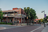 Street in old town of Wichita under clear sky with restaurant, Kansas, USA