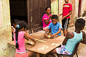A group of kids play dominos in the street of Havana, Cuba