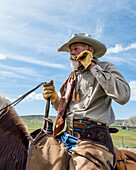 Old cowboy on cattle drive through Maybell, Colorado, USA