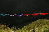 Side view of people lying in hammocks and hanging on high line, Tijesno Canyon, Banja Luka, Bosnia and Herzegovina