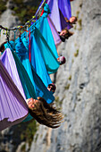 Side view of people lying in hammocks above mountains, Tijesno Canyon, Banja Luka, Bosnia and Herzegovina
