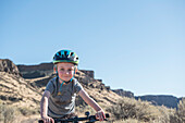 A young boy on a bike at Frenchmans Coulee, WA.