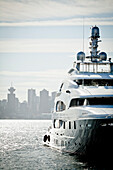 Front view of yacht against skyline of city of Vancouver, British Columbia, Canada