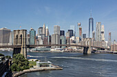 panorama of the brooklyn bridge and the manhattan skyline with one world trade center seen from the manhattan bridge, east river, brooklyn bridge, architecture, monument, financial district, financial district, new york city, new york, united states, usa