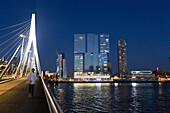 in the background contemporary architecture, the holland amerika lun and the erasmus bridge, promenade along the meuse, rotterdam, willemsplein, the netherlands