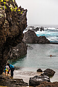 natural pool in porto-moniz, behind this peaceful swim the waves break violently, madeira, portugal.