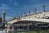 France, Ile de France, Paris, 7th district, tour boats under the Alexander III bridge