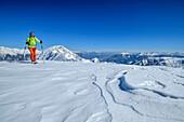 Woman backcountry-skiing ascending towards Hoher Bolz, Hoher Bolz, Kreuzeck Group, Hohe Tauern range, Carinthia, Austria