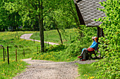 Three persons sitting near hut and having a break, Albsteig, Black Forest, Baden-Wuerttemberg, Germany