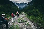 hiker direction Memminger Hütte, E5, Alpenüberquerung, 2nd stage, Lechtal, Kemptner Hütte  to Memminger Hütte, tyrol, austria, Alps