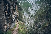 Long distance hiking path along a rock wall, E5, Alpenüberquerung, 3rd stage, Seescharte,Inntal, Memminger Hütte to  Unterloch Alm, tyrol, austria, Alps