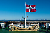 norwegian flag on deck of the ferry from Andenes to Gryllefjord, Senja, Norway