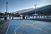 sport court with view at surrounding Andean Peaks at Ricaurte Park, Villa de Leyva, Departamento Boyacá, Colombia, South America