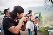 Colombian aiming with toy weapon, Salento, UNESCO World Heritage Coffee Triangle, Departmento Quindio, Colombia, Southamerica