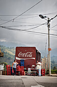 two locals talking to each other in front of Coca Cola truck, Salento, UNESCO World Heritage Coffee Triangle, Departmento Quindio, Colombia, Southamerica