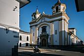 motorbike driver in front of Iglesia San Jose church, Popayan, Departmento de Cauca, Colombia, Southamerica