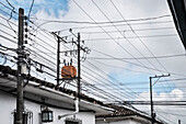 tangle of power poles and supply lines in detail, Popayan, Departmento de Cauca, Colombia, Southamerica