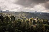 view from Cerro El Morro mountain and surrounding green landscape where white church is outstanding, Popayan, Departmento de Cauca, Colombia, Southamerica