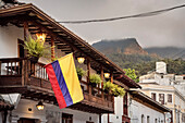 colonial house with colombian flag attached to wooden balcony, capital Bogota, Departmento Cundinamarca, Colombia, Southamerica