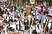 Musicians and people in Bavarian costumes from wild operator in the Chiemgau the pageant in unterwössen