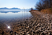Shallow Water beside a gravel bank in Lake Chiemsee and the Chiemgau mountains in the background