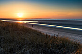 sunset the beach  in winter, East Frisian Islands, Spiekeroog, Lower Saxony, North Sea, Germany